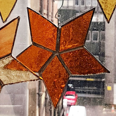 Five point star amber stained glass
