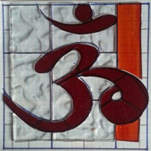 Om handmade stained glass panel in red, orange and clear